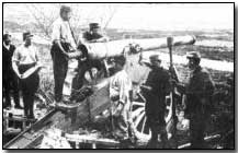 Belgian artillery positioned behind a canal