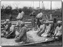 Indian troops praying.  Indian troops served in great numbers at Neuve Chapelle.