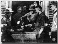 YMCA worker Mrs. F. T. Fitzgerald serving hot chocolate in Bouillonville