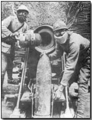 French gun crew wearing gas gear