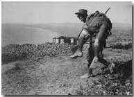 Australian soldier carrying wounded comrade, Gallipoli, 1915