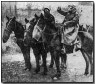 Men on horseback with gas masks