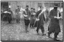 French prisoners with morning soup ration