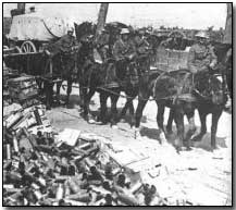 Canadian transport passing piles of spent shell casings at Vimy Ridge